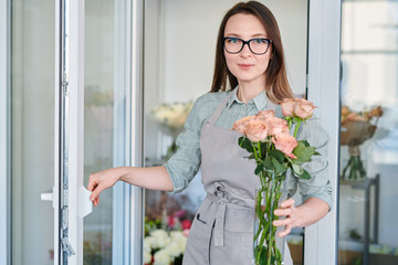 Florist with bunch of roses