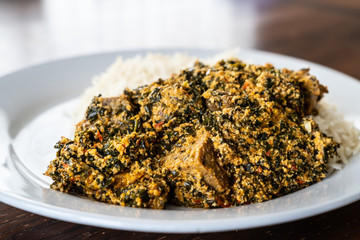 Nigerian Egusi Melon soup served with white rice at restaurant
