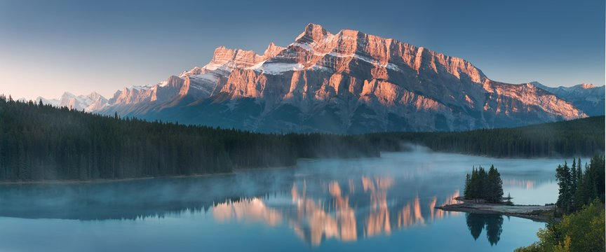 The mountain views when you are in Two Jack Lake campground of Banff National Park in Alberta, Canada. Typical landscape for North America. Amazing landscape background concept