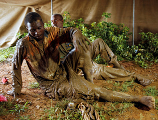 Artisanal miners Thnkmore Mandimutsa and Simon Mushonga sit in a tent after being rescued in Kadoma