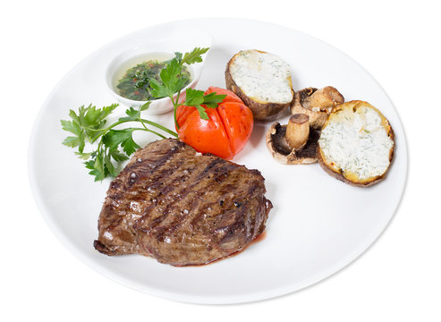 Beef steak with chimichurri sauce and vegetables.
