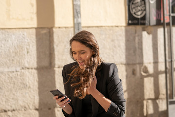 young woman talking on the mobile phone with her boyfriend happy and smiling