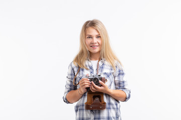 Technologies, photographing and people concept - blonde young woman with retro camera over white background