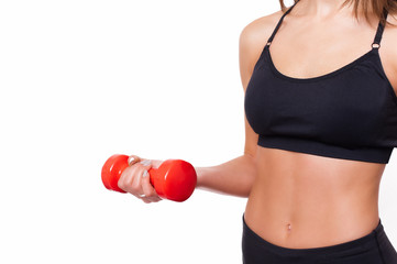 Sportive athletic woman with dumbbell pumping up muscle biceps, ..concept fitness