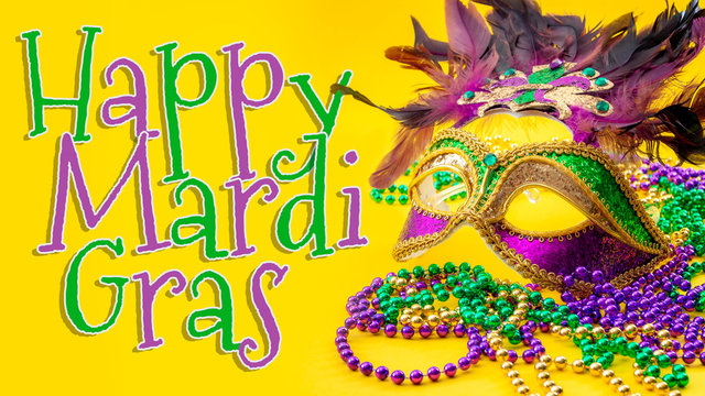 Happy Mardi Gras and Fat Tuesday carnival concept theme with close up on a face mask full of color, feathers and texture and golden, green and purple beads isolated on yellow background with text