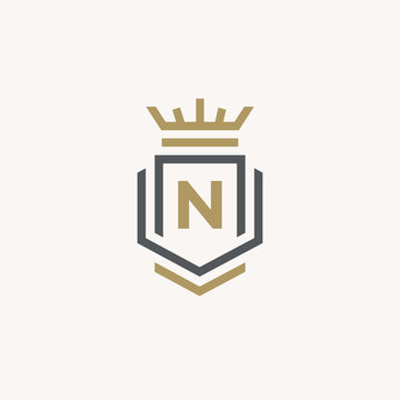 Heraldic Letter N monogram. Elegant minimal logo design. Letter N + Crown + Book + Shield.