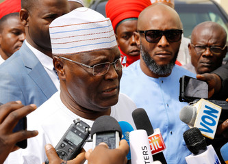 Nigeria's main opposition party presidential candidate Atiku Abubakar speaks to reporters, after the postponement of the presidential election in Yola