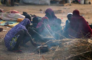 Internally displaced women prepare breakfast at the Teachers village camp in Maiduguri