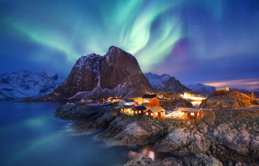 Aurora borealis on the Lofoten islands, Norway. Green northern lights above ocean. Night sky with polar lights. Night winter landscape with aurora and reflection on the water surface. Norway-image Fototapete