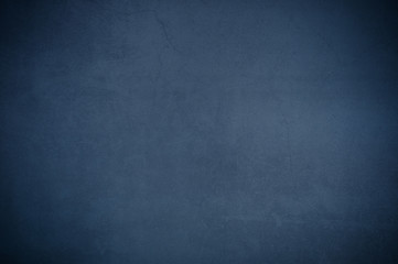 Background wall of aged textured old plaster blue.