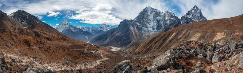 Great panoramic mountain range. Ama Dablam, Kangtega, Tobuche, Taboche. View from The Everest memorial near Dughla village.
