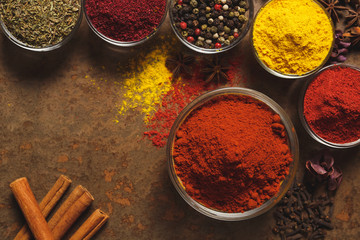 Red Ground Paprika. Place for text. Different types of Spices in a bowl on a stone background. The view from the top