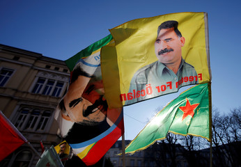 Pro-Kurd protesters hold flags with portraits of jailed PKK leader Ocalan as they take part in a demonstration in support to him in Strasbourg