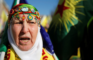 A pro-Kurd protester takes part in a demonstration in support of jailed PKK leader Ocalan in Strasbourg