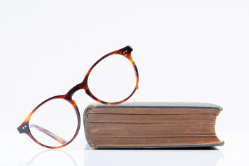 Glasses with book education and back to school concept picture