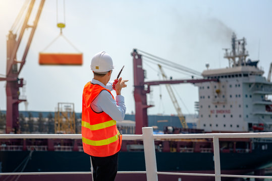 stevedore, loading master, port captain or supervisor in charge of command working on board the ship in port for safety loading discharging operation