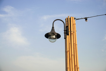 Three lamp with bamboo pipe standing ang blue sky background