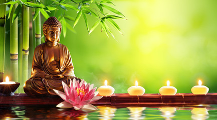 Foto op Textielframe Boeddha Buddha Statue With Candles In Natural Background