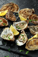 Fresh Oysters platter with lemon and ice