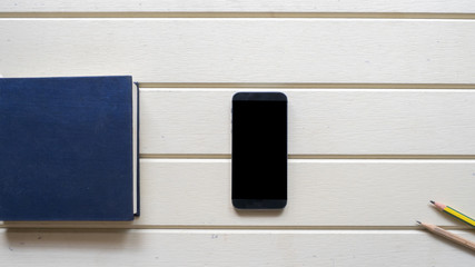 Wall Mural - top view with notebook and smart phone on wood background