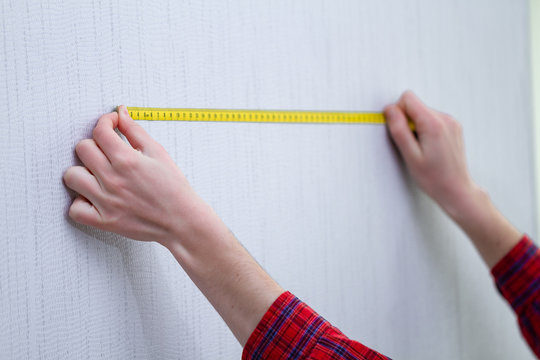 Home repairs and measuring the length of the wall by tape measure