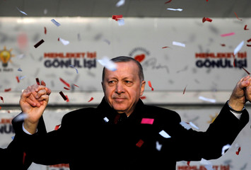 Turkish President Tayyip Erdogan reacts during a rally for the upcoming local elections in Istanbul