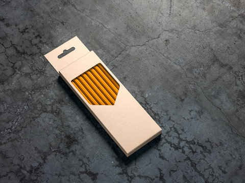 Pencils Set cardboard box Mockup on concrete floor