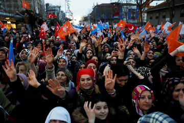 Supporters of Turkish President Tayyip Erdogan react during a rally for the upcoming local elections in Istanbul