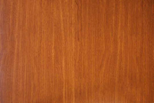 Abstract Background of a cherry wood or wooden table surface with fine texture