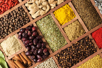 Fototapete - Various condiments  with showcases of  Indian market. Colorful spices and herbs as a background for design.