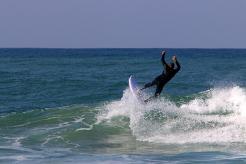 Surfing - riding the waves in the Mediterranean on special light boards.