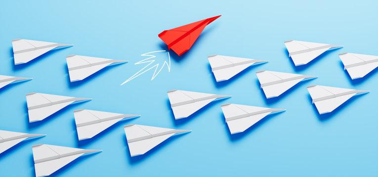 Roter Papierflieger bei Kurswechsel - Durchstarten