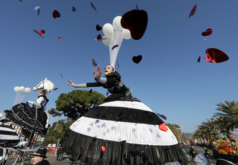 Artist performs during the flower parade as part of the Carnival of Nice