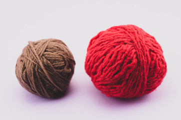 red brown wool balls side by side - objects and materials still life
