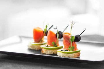 Gourmet appetizers with red fish and lime and sesame. Concept of food, restaurant, catering, menu.