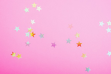 Bright plastic pink color with small shiny stars. Brilliant background for your festive project