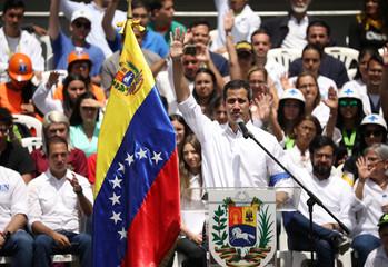 Venezuela's Juan Guaido attends a meeting with volunteers to coordinate humanitarian aid in Caracas