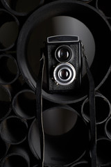 Love for photography, creativity. Camera on black abstract background. Learning photography.
