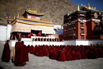 "Tibetan monks attend a ceremony at the Labrang Monastery ahead of ""Sunbathing Buddha Festival"", in Xiahe county"