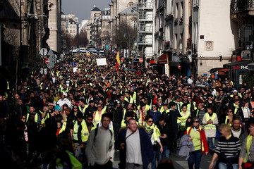"""Protesters wearing yellow vests take part in a demonstration of the """"yellow vests"""" movement in Paris"""