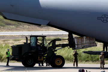 Humanitarian aid for Venezuela is unloaded from a U.S. Air Force plane at Camilo Daza Airport in Cucuta