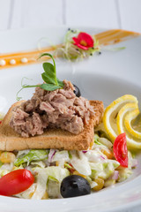 fresh healthy tuna salad appetizer on white plate