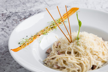 italian spahetti carbonara pasta in white plate