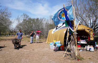 The Carrizo/Comecrudo Tribe of Texas border wall protest camp called Yalui Village is pictured in the Eli Jackson Cemetery near San Juan