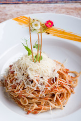 italian spaghetti amatriciana pasta on white plate