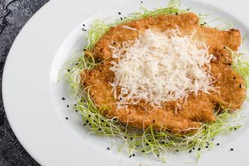 tasty delicious fried chicken schnitzel in restaurant setting
