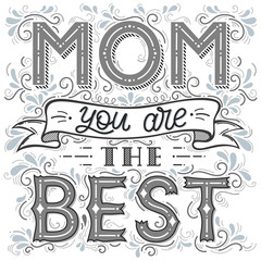 Happy Mothers Day typography.Mom you`re the best - unique hand drawn lettering with swirls,ribbon and decoration elements.Seasons greetings card perfect for prints,banners,invitations and more.