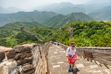 Wall Mural - China travel at Great Wall. Tourist in Asia walking on famous Chinese tourist destination and attraction in Badaling north of Beijing. Woman traveler hiking great wall enjoying her summer vacation.