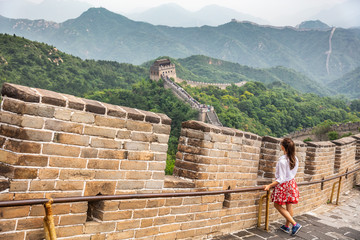 Wall Mural - Travel tourist in Great Wall of China, Beijing tourist attraction chinese destination. Asian woman traveling in Asia vacation world tour.