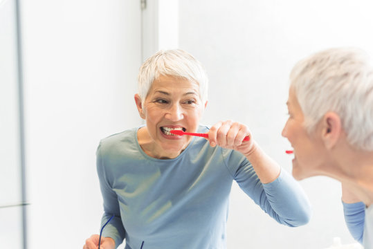 Woman washing her teeth